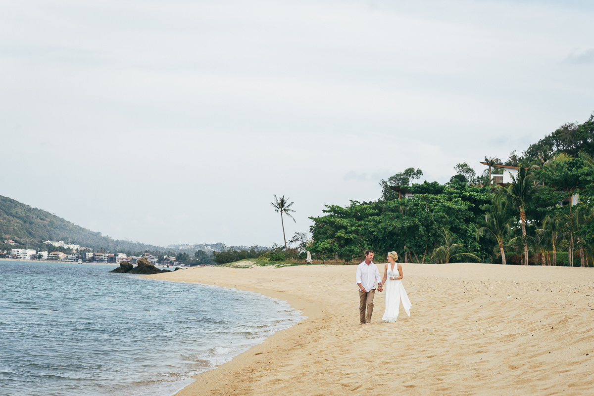 bride and groom on sand