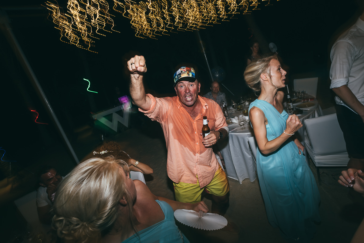 wedding guest dancing on beach