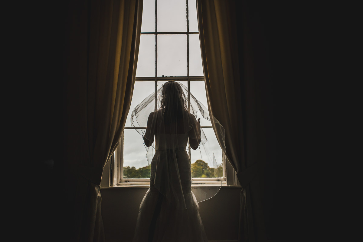 bride in bridal suite at somerford hall