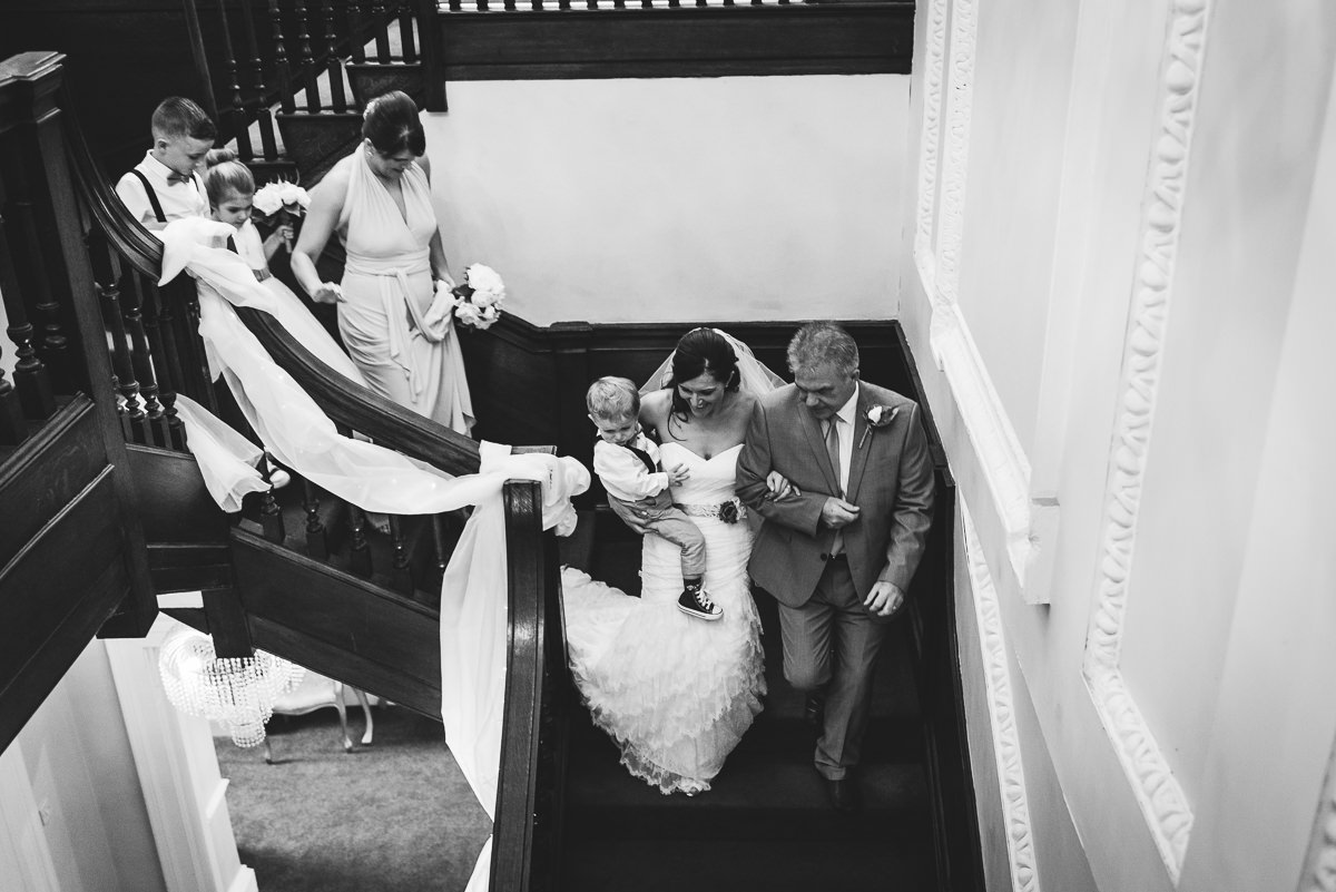 natural photograph of bride walking down stairs
